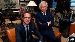 Designer Ralph Lauren (r) poses in his office accompanied by Stefan Larsson, global president of Old Navy, Sept. 29, 2015, in New York.