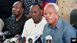 Opposition party presidential candidate Edward Lowassa, right, speaks to the media at a news conference in Dar es Salaam, Tanzania, Oct. 28, 2015.