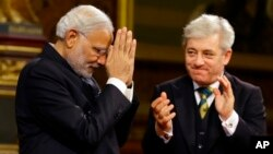 Britain's John Bercow, speaker of the House of Commons, applauds India's Prime Minister Narendra Modi after he delivers a speech at Parliament in London, Nov. 12, 2015.