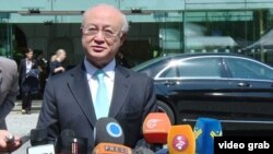 FILE - International Atomic Energy Agency Director-General Yukiya Amano speaks to reporters outside the Palais Coburg, the venue for nuclear talks in Vienna, July 4, 2015.