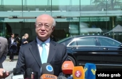 International Atomic Energy Agency Director-General Yukiya Amano speaks to reporters outside the Palais Coburg, the venue for nuclear talks in Vienna, July 4, 2015.