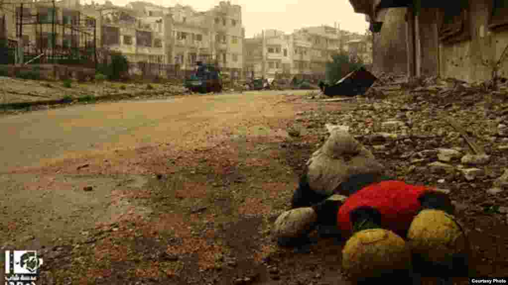 A Mickey Mouse doll lies abandoned in the Al-Khaldiya district of Homs, January 3, 2013 (Lens Young Homsi)