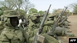 Child soldiers of the Sudan People's Liberation Army wait in a file photograph from 2001.