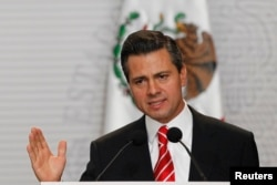 Mexico's President Enrique Pena Nieto speaks during the presentation of a telecommunications reform bill in Mexico City, March 11, 2013.