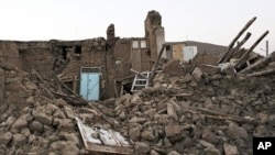 Ruins of a building in a village near the city of Varzaqan in northwestern Iran, after an earthquake, Aug. 13, 2012.