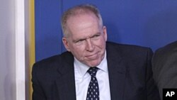 John Brennan exits a daily news briefing at the White House, May 2, 2011