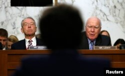 Senate Judiciary Committee Chairman Chuck Grassley, left, and ranking member Pat Leahy question Loretta Lynch during her confirmation hearing to become U.S. attorney general, on Capitol Hill in Washington, Jan. 28, 2015.
