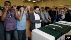 Funeral prayers are offered for Pakistani exchange student Sabika Sheikh, who was killed in the Santa Fe High School shooting, during a service at the Brand Lane Islamic Center Sunday, May 20, 2018, in Stafford, Texas. (AP Photo/David J. Phillip)