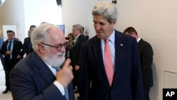 European Union Climate Commissioner Miguel Arias Canete (L) welcomes US Secretary of State John Kerry for talks to reduce hydrofluorocarbons under the Montreal Protocol at Vienna International Center in Vienna, Austria, July 22, 2016.