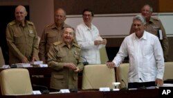 Cuba's President Raul Castro, front left, and Vice President Miguel Diaz-Canel, front right, attend a National Assembly session in Havana, Cuba, July 15, 2015.