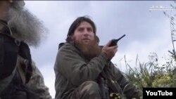 """""""YouTube"""" orqali tarqalgan videodan olingan Al-Shishaniy tasviri. 2015-yil aprel."""