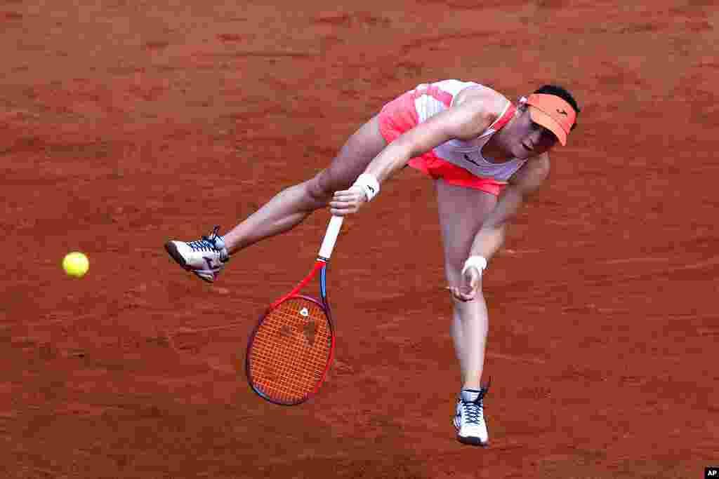 Slovenia's Tamara Zidansek serves to Spain's Paula Badosa during their quarterfinal match of the French Open tennis tournament at the Roland Garros stadium in Paris.