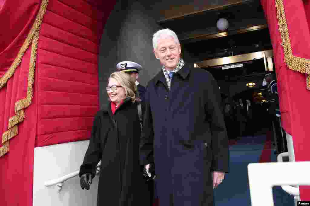 Former U.S. President Bill Clinton and Secretary of State Hillary Clinton arrive for the presidential inauguration on the West Front of the U.S. Capitol in Washington January 21, 2013