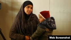 FILE - Hoda Muthana is seen with her son is this undated photo.