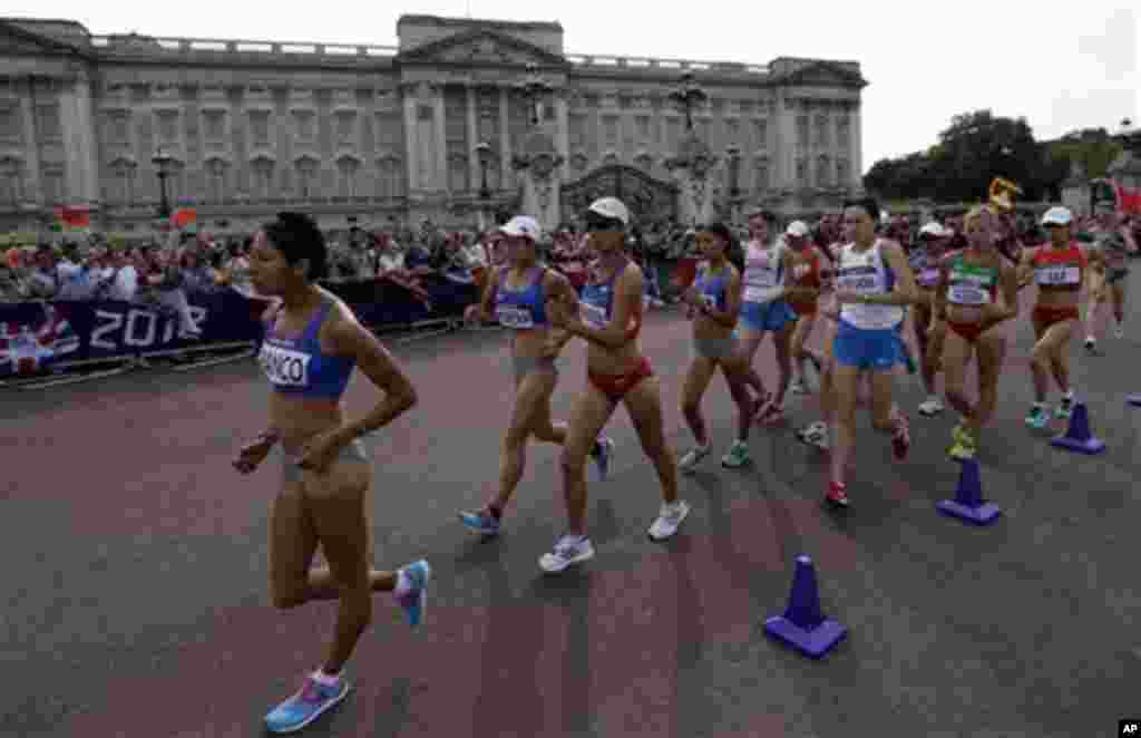 Athletes walk past Buckingham Palace as they compete in the women's 20-kilometer race walk.