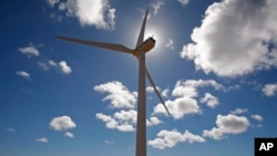 FILE - This wind turbine is one of several used to generate electricity near the small town of Darling, on the outskirts of Cape Town, South Africa.
