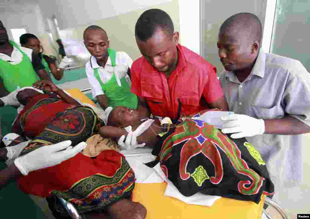 Paramedics at the Malindi district hospital attend to a child injured when their community members were attacked at Tana River district in Kenya's coastal Tana Delta region December 21 2012.