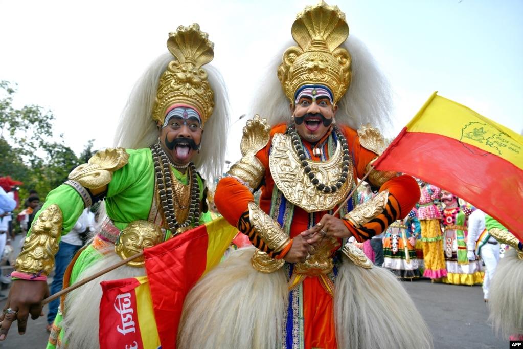 """Veeragase"" folk artists of Karnataka dressed as deities take part in a rally during ""Mahaveer Jayanthi"" festival celebrations in Bangalore, India."