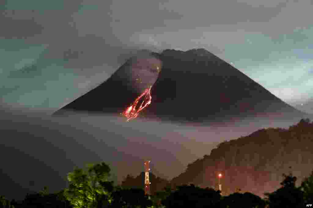 Lava flows down from the crater of Mount Merapi, Indonesia's most active volcano, as seen from Kaliurang in Yogyakarta.