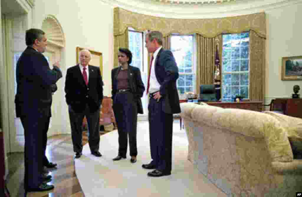 In this October 7, 2001 file photo, President George W. Bush, right, meets with CIA Director George Tenet, Vice President Dick Cheney and National Security Adviser Condoleezza Rice in the Oval Office after the president informed the nation that air strike
