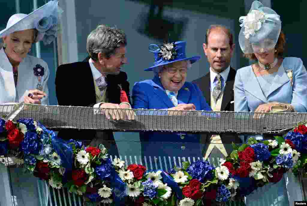 June 2: Britain's Queen Elizabeth after the Derby horse race in Epsom, England during her Diamond Jubilee celebrations.