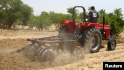 A farmer plows the field in Saulawa village, on the outskirts of Nigeria's north-central state of Kaduna in this May 2013 photo.
