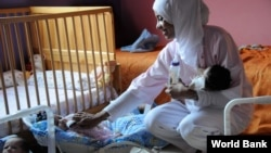 A healthcare worker tends to orphans in Marrakech, Morocco. The country is making substantial progress in improving childhood and maternal health, a UN Millennium Development Goal. (World Bank)