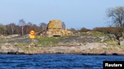FILE - A mock road-traffic sign prohibiting submarines is seen April 29, 2015, marking the site where a Russian Whiskey-class submarine ran aground near the Swedish naval port of Karlskrona in 1981.