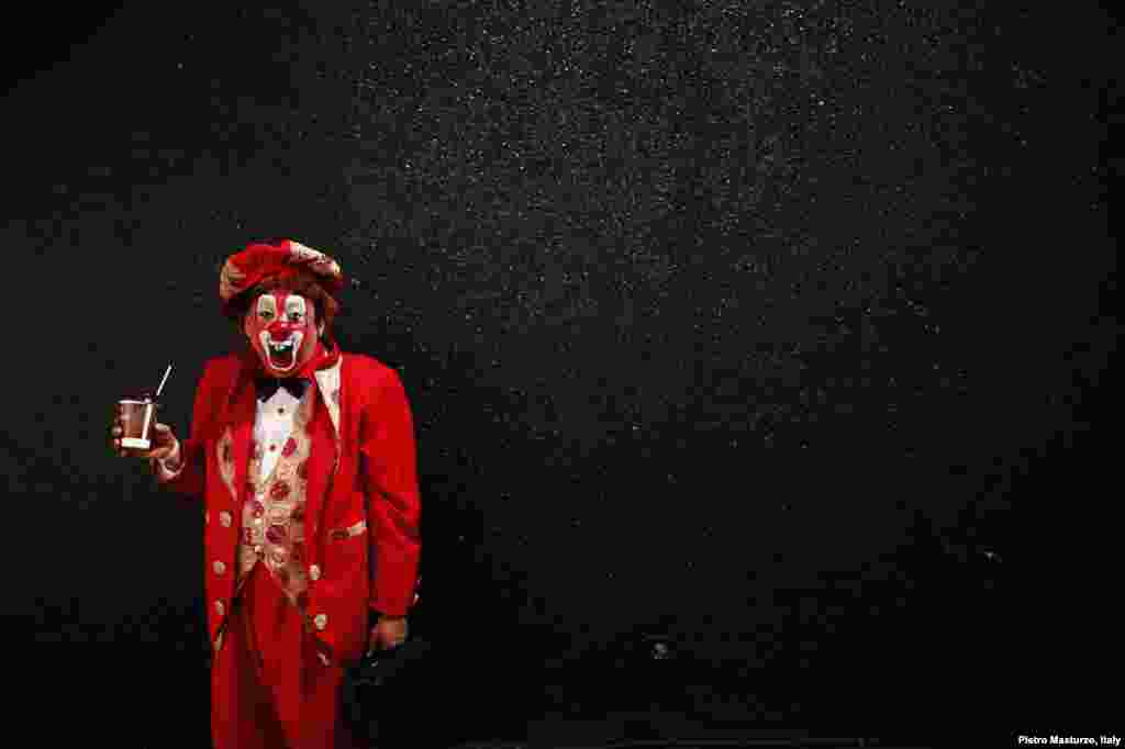 """Resortito"", a clown, rallies for peace during the 18th Latin American clown convention or ""Fair of Laughter"" in Mexico City, Mexico, Oct. 23, 2013."