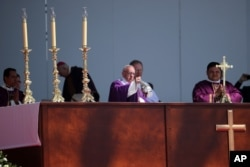 Pope Francis begins Mass in Ecatepec, Mexico, Sunday, Feb. 14, 2016. Hundreds of thousands of people gathered as Pope Francis began a Mass, expected to be the biggest event of his five-day trip to Mexico.