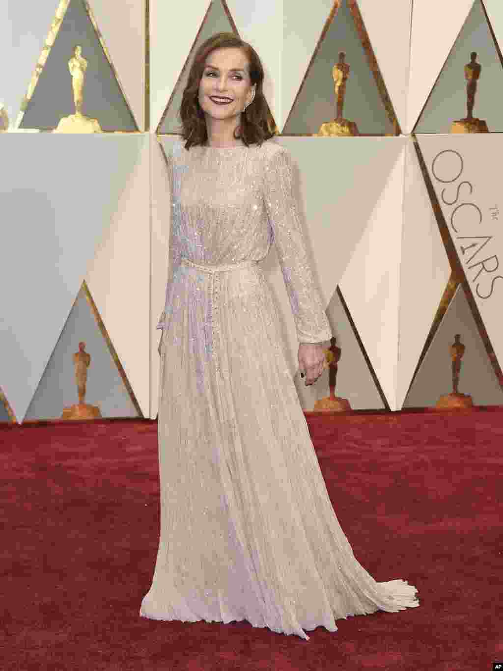 Isabelle Huppert arrives at the Oscars on Sunday, Feb. 26, 2017, at the Dolby Theatre in Los Angeles.