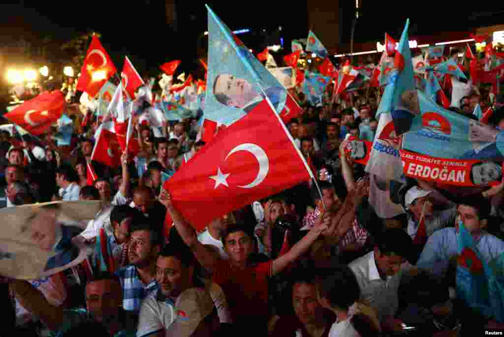 Supporters of Turkey's Prime Minister Tayyip Erdogan celebrate his election victory in front of the party headquarters, in Ankara, Aug. 10, 2014.