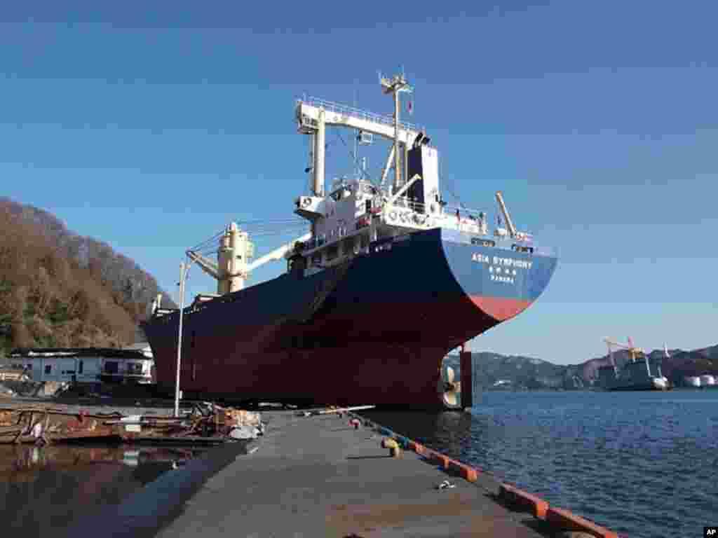 The 6,000-ton 'Asia Symphony' was washed onto the Kamaishi docks by the tsunami (VOA 0 H. Ridgwell)