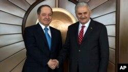 Turkey's Prime Minister Binali Yildirim, right, shakes hands with Iraqi Kurdish leader Massoud Barzani, in Ankara, Turkey, Feb. 27, 2017.