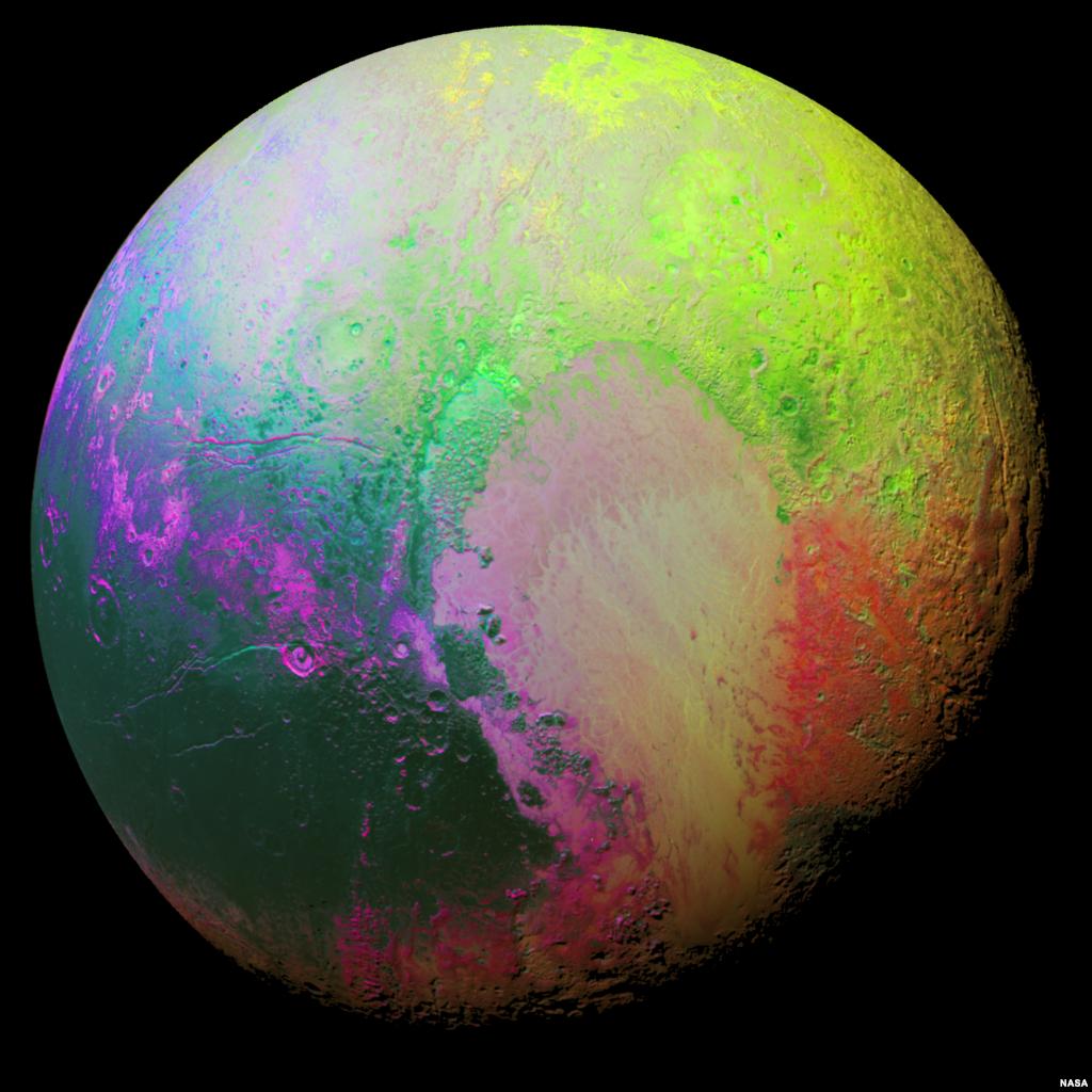 """Para ilmuwan anggota tim pesawat antariksa """"New Horizons"""" membuat gambar warna-warni Pluto untuk menggambar daerah-daerah di permukaan Pluto yang berbeda-beda. Foto diambil oleh New Horizons dari jarak 35.000 km dari Pluto."""