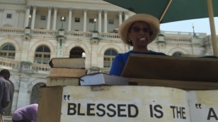 FILE - A woman reads from the Bible during the 90-hour U.S. Capitol Bible Reading Marathon in Washington, D.C., May 6, 2015. (Photo: J. Socolovsky / VOA)