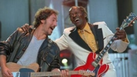 "Bruce Springsteen and Chuck Berry during the performance of ""Johnny B. Goode"" at a concert for the Rock and Roll Hall of Fame in Cleveland, Ohio, in 1995"