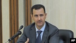In this photo taken by the Syrian official news agency SANA, Syrian President Bashar Assad addresses a meeting for the central committee of the Baath party in Damascus, Syria, August 17, 2011
