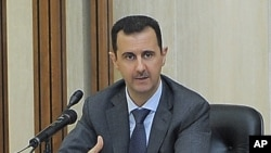 Syrian President Bashar Assad addresses a meeting for the central committee of the Baath party in Damascus, August 17, 2011