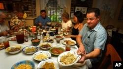 Diners eat at Mrs. Wilkes' restaurant in Savannah, Georgia