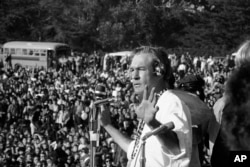 "In this Jan. 14, 1967 photo, Timothy Leary addresses a crowd of hippies at the ""Human Be-In"" that he helped organize in Golden Gate Park, San Francisco, Calif. Leary told the crowd to ""Turn on, Tune in and Drop out""."