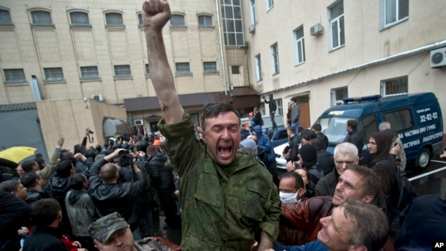 A man cheers after being released from a local police station after it was stormed by pro-Russian protesters in Odessa, Ukraine, on May 4, 2014.
