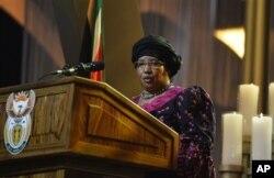 FILE - Malawi President Joyce Banda speaks during funeral service for Nelson Mandela, Qunu, South Africa, Dec. 15, 2013.