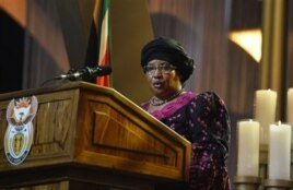 FILE - Malawi President Joyce Banda speaks during funeral service for Nelson Mandela, Qunu, South Africa, Dec. 15, 2013.