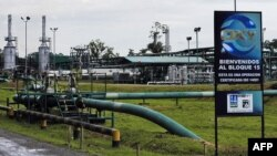 FILE - General view of the U.S. Occidental Petroleum Corporation's (OXY) industrial plant in Lago Agrio, in the Ecuadorean Amazonia, May 24, 2006.