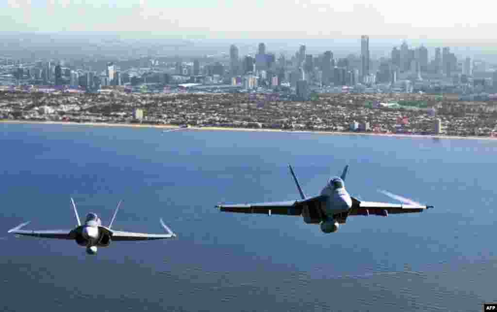 Two Royal Australian Air Force fighter jets, an F/A-18 Hornet (L) and an F/A-18F Super Hornet, fly over Port Philip Bay as part of the Australian International Airshow in Melbourne on March 2. (Reuters/Commonwealth of Australia)
