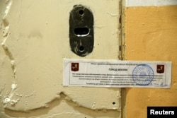 FILE - The office door of rights group Amnesty International is sealed off in Moscow, Russia, Nov. 2, 2016.