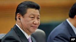 FILE - Chinese President Xi Jinping attends a meeting at the Great Hall of the People in Beijing.