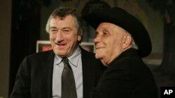 "FILE - Jake LaMotta, right, and actor Robert DeNiro stand for photographers before watching a 25th anniversary screening of the movie ""Raging Bull"" in New York, Jan. 27, 2005."