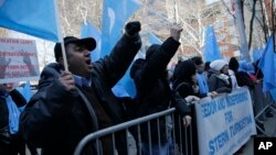 Uighurs and their supporters protest in front of the Permanent Mission of China to the United Nations in New York, March 15, 2018.
